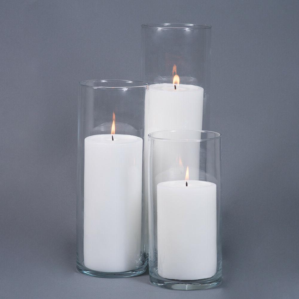 4 pillar candles and 5 eastland cylinder