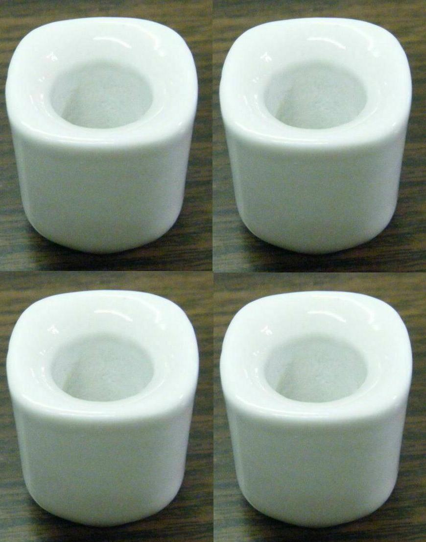 lot of 4 white ceramic candle holders
