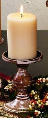 small wooden pillar and votive candle candlestick